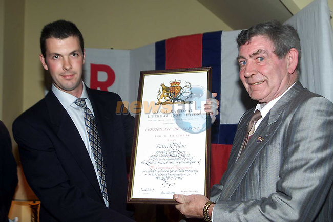 Owen Medland R.N.L.I. presenting Paddy Flynn (Tractor Driver) with a certificate of Service.Picture: Paul Mohan/Newsfile