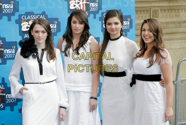 ALL ANGELS.The Classical Brit Awards 2007, Royal Albert Hall, London, England. .May 3rd, 2007.half length white dress black belt hand on hip .CAP/AH.©Adam Houghton/Capital Pictures