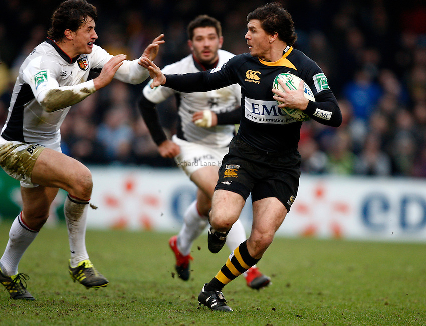 Photo: Richard Lane/Richard Lane Photography.  London Wasps v Stade Toulouse. Heineken Cup. 23/01/2011. Wasps' Ben Jacobs is tackled by Yannick Jauzion of Toulouse.