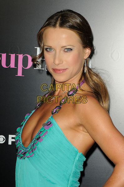 "EDYTA SLIWINSKA.arriving at the premiere of CBS Films' ""The Back-up Plan"" at the Regency Village Theatre in Westwood, California, USA, April 21st 2010..arrivals portrait headshot side turquoise halterneck purple chain weave .CAP/ROT.©Lee Roth/Capital Pictures"