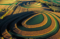 Aerial view of the Campbellsport drumlins, large rounded mounds left by a receding glacier that are now being plowed for agricultural use, forming circular patterns. National Scientific Reserve. agriculture, crops, landscape,. Campbellsport Wisconsin.