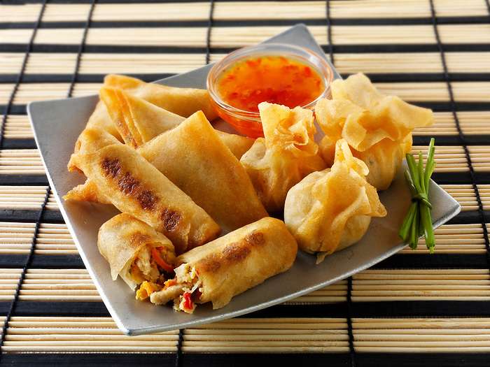 Oriental selection with dim sum,  spring rollswith chicken & vegetables and vegetable samosas with a chilli  dipping sauce