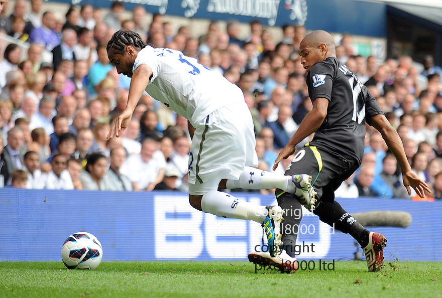Benoit Assou-Ekotto of Tottenham Hotspur is fouled during Barclays Premier League match between Tottenham Hotspur and Norwich City at White Hart Lane on September 1, 2012 in London, England. Picture Zed Jameson/pixel 8000 ltd.