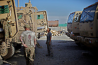US ARMY Specialist Kahaya Komar (center) prepares her truck for a day long logistical mission at  Forward Operating Base Fenty in the outskirts of Jalalabad, Afghanistan on Wednesday  May 1, 2010...Specialist Komar is a radio operator and assistant gunner on logistical convoys with Destro Platoon, Fury Company, 2nd Battalion, 4th Brigade, Task Force Mountain Warrior, 4th Infantry Division..