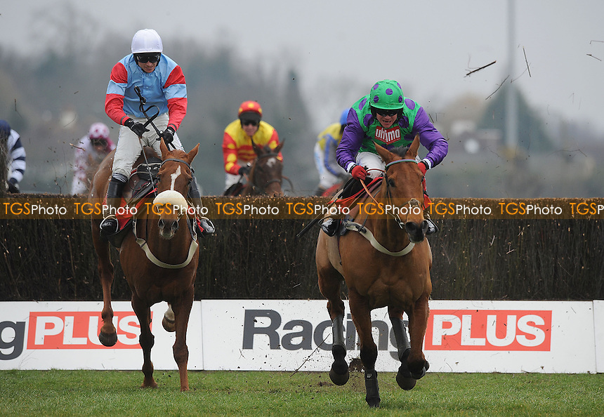Midnight Sail ridden by Robert Thornton jumps the last from Lexicon Lad and Paddy Brennan and goes on to win the racingplus.co.uk Pendil Novices´ Chase (Grade 2) Cl1  - Horse Racing at Kempton Park Racecourse, Sunbury, Middlesex - 23/02/2013 - MANDATORY CREDIT: Martin Dalton/TGSPHOTO - Self billing applies where appropriate - 0845 094 6026 - contact@tgsphoto.co.uk - NO UNPAID USE.