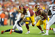 Landover, MD - August 24, 2018: Washington Redskins quarterback Alex Smith (11) is tackled for a loss during preseason game between the Denver Broncos and Washington Redskins at FedEx Field in Landover, MD. The Broncos defeat the Redskins 29-17. (Photo by Phillip Peters/Media Images International)