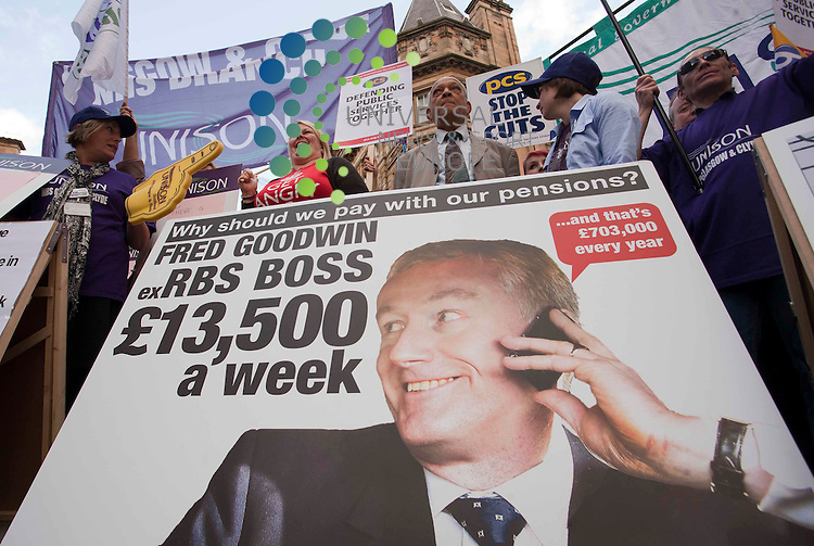 Members of Scotland's major unions gather in Buchanan Street Glasgow to protest  and mark the day before the PCS strike by highlighting ex-RBS boss Fred Goodwin's massive pension while their own is under threat. Picture: Johnny Mclauchlan Universal News and Sport (Europe).29/07/2011