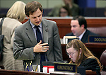 Nevada Assembly Democrats Elliot Anderson and Maggie Carlton work on the Assembly floor at the Legislative Building in Carson City, Nev., on Thursday, May 21, 2015. <br /> Photo by Cathleen Allison