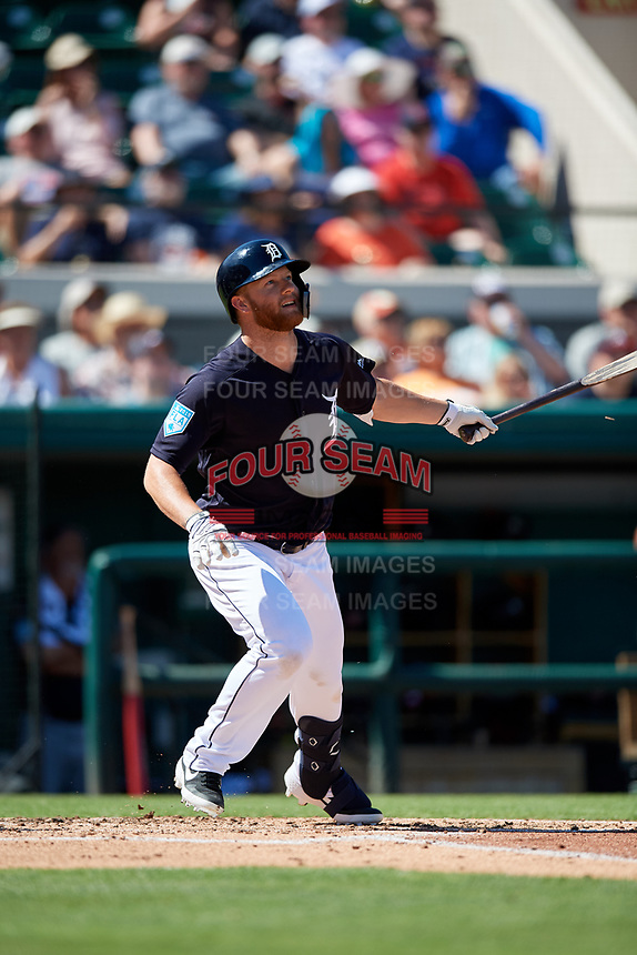 Detroit Tigers designated hitter Dustin Peterson (13) follows through on a swing during a Grapefruit League Spring Training game against the Atlanta Braves on March 2, 2019 at Publix Field at Joker Marchant Stadium in Lakeland, Florida.  Tigers defeated the Braves 7-4.  (Mike Janes/Four Seam Images)