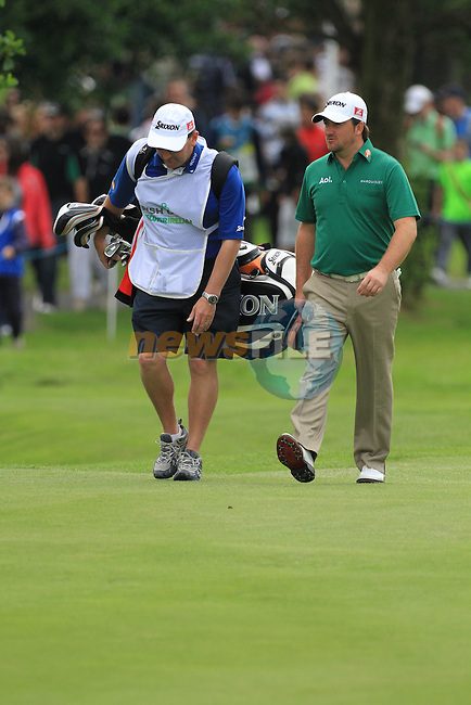 Graeme McDowell (NIR) and caddy Ken Comboy walk down the 5th hole during Day 3 Saturday of The Irish Open presented by Discover Ireland at Killarney Golf & Fishing Club on 30th July 2011 (Photo Fran Caffrey/www.golffile.ie)