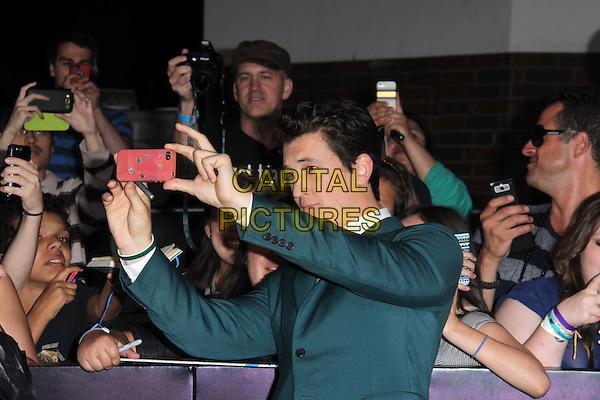 WESTWOOD, CA - March 18: Miles Teller at the &quot;Divergent&quot; Los Angeles Premiere, Regency Bruin Theatre, Westwood,  March 18, 2014. <br /> CAP/MPI/JO<br /> &copy;Janice Ogata/MediaPunch/Capital Pictures