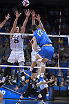 LOS ANGELES - MAY 5:  Nick Amado #25 and Kyle Ensing #5 of the Long Beach State 49ers defend the shot against Christian Hessenauer #17 of the UCLA Bruins during the Division 1 Men's Volleyball Championship on May 5, 2018 at Pauley Pavilion in Los Angeles, California. The Long Beach State 49ers defeated the UCLA Bruins 3-2. (Photo by John W. McDonough/NCAA Photos via Getty Images)