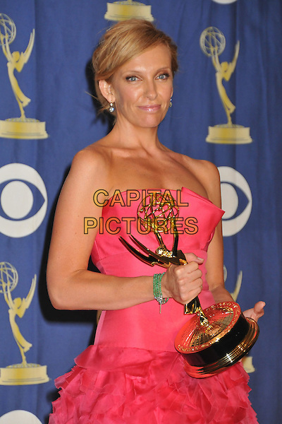 TONI COLLETTE .Attending the 61st Annual Primetime Emmy Awards held at NOKIA Theatre L.A. LIVE, Los Angeles, California, USA, .20th September 2009..pressroom press room emmys half length trophy award strapless pink dress green stone bracelet hair up .CAP/ADM/BP.©Byron Purvis/Admedia/Capital Pictures