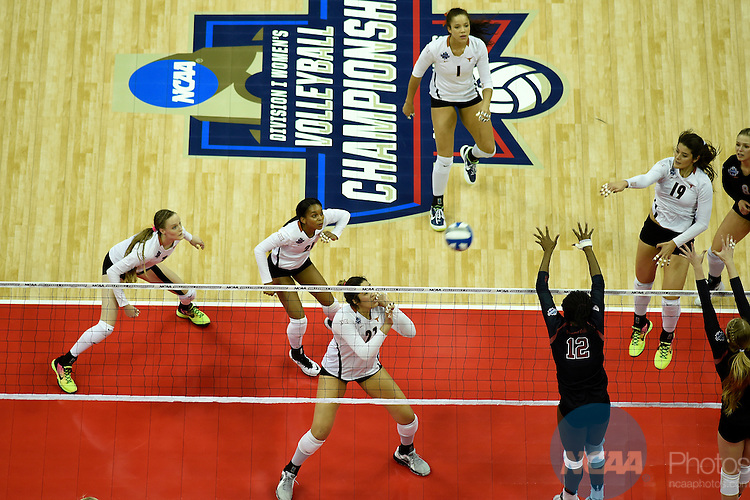COLUMBUS, OH - DECEMBER 17:  Paulina Prieto Cream (19) of the University of Texas tries for a kill against Stanford University during the Division I Women's Volleyball Championship held at Nationwide Arena on December 17, 2016 in Columbus, Ohio.  Stanford beat Texas 3-1 to win the national title. (Photo by Jamie Schwaberow/NCAA Photos via Getty Images)