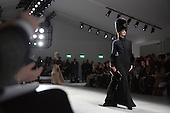 14 February 2014, London, England, UK. A model walks the runway at the DAKS catwalk show during London Fashion Week AW14 at the BFC Courtyard Show Space/Somerset House.