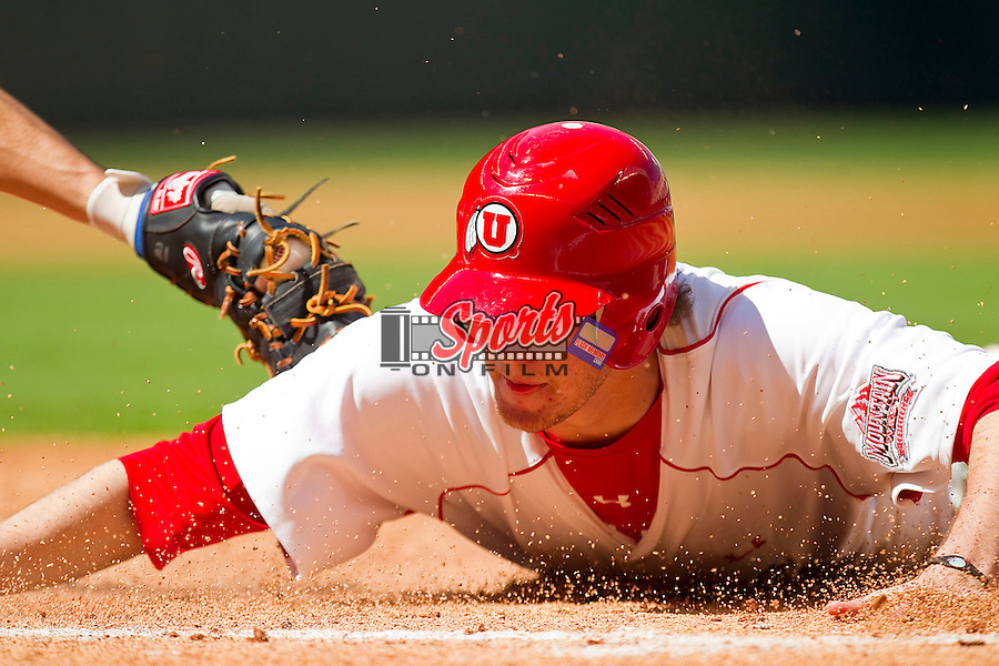 Josh Alexander #26 of the Utah Utes dives back into first base during the game against the Kentucky Wildcats at Minute Maid Park on March 6, 2011 in Houston, Texas.  Photo by Brian Westerholt / Four Seam Images