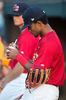 Eliezer Alvarez (11) of the Johnson City Cardinals signs an autograph prior to the game against the Bristol Pirates at Howard Johnson Field at Cardinal Park on July 6, 2015 in Johnson City, Tennessee.  The Cardinals defeated the Pirates 8-2 in game two of a double-header. (Brian Westerholt/Four Seam Images)