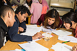 Education High School students conducting experiment in science class