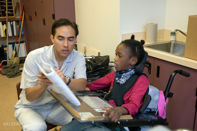 Oakland CA Developmentally disabled primary school girl being given standardized test by her teacher in private space away from class  MR