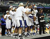 Fellow players hug Jasmine Thomas as she is named the Tournament MVP. This was the Championship game of the 2011 ACC Tournament in Greensboro on March 6, 2011. Duke beat UNC 81-66. (Photo by Al Drago)
