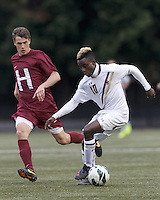 Boston College midfielder Derrick Boateng (10) dribbles.Boston College (white) defeated Harvard University (crimson), 3-2, at Newton Campus Field, on October 22, 2013.