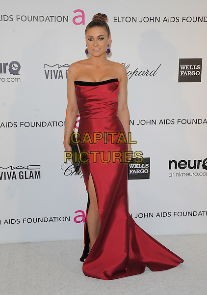 Carmen Electra.The 21st Annual Elton John AIDS Foundation Academy Awards Viewing Party held at The City of West Hollywood Park in West Hollywood, California, USA..February 24th, 2013.oscars full length red strapless silk satin dress black clutch bag hair up bun slit split                                        .CAP/DVS.©DVS/Capital Pictures.
