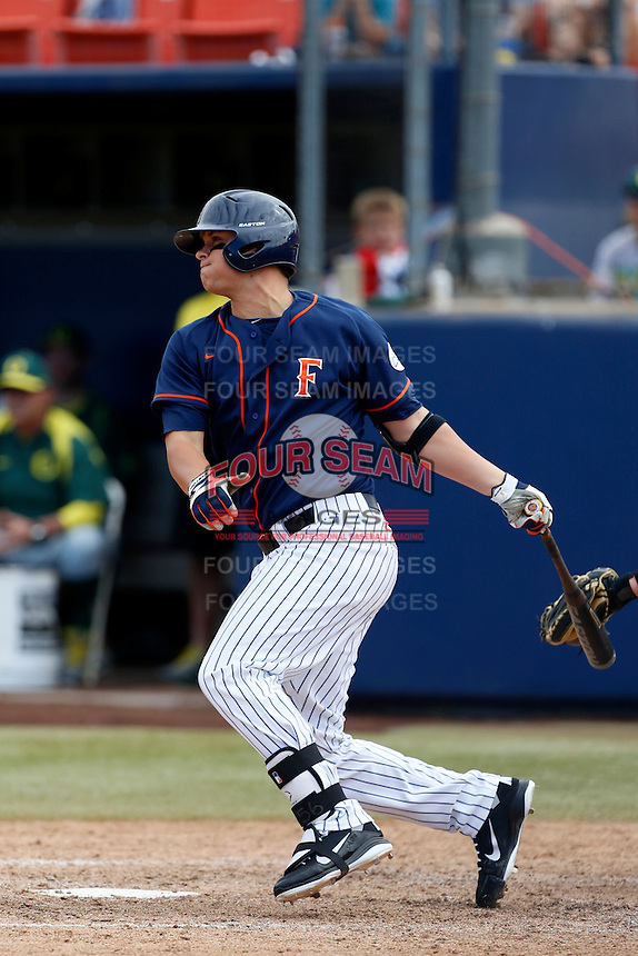 J. D. Davis #26 of the Cal State Fullerton Titans bats against the Oregon Ducks at Goodwin Field on March 3, 2013 in Fullerton, California. (Larry Goren/Four Seam Images)