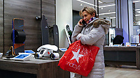 NEW YORK, NY - FEBRUARY 25:  A woman talks by phone as she visits the Macy's headquarter on February 25, 2019 in Manhattan, New York. Earnings reports of $2.53 is expected for Macy's Inc. with a share on sales of $8.4 billion before the market opens Feb. 26,.  (Photo by Eduardo Munoz Alvarez/VIEWpress)
