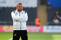 Billy Reid, assistant manager for Swansea during the pre-match warm-up for the Sky Bet Championship match between Swansea City and Rotherham United at the Liberty Stadium in Swansea, Wales, UK.  Friday 19 April 2019