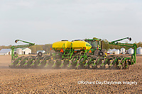 63801-09918 Farmer planting corn Marion Co. IL