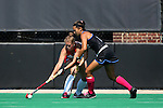 02 October 2016: Boston's Ally Hammel (left) and Duke's Caroline Andretta (right). The Duke University Blue Devils hosted the Boston University Terriers at Jack Katz Stadium in Durham, North Carolina in a 2016 NCAA Division I Field Hockey match. Duke won the game 2-1.