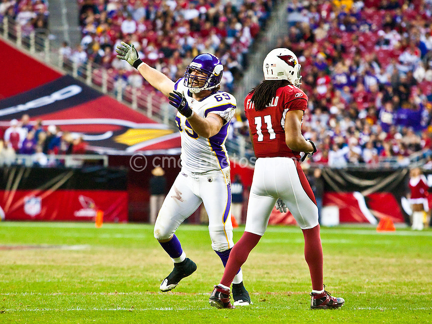 Dec 14, 2008; Glendale, AZ, USA; Minnesota Vikings defensive end Jared Allen (69) celebrates a sack in front of Arizona Cardinals wide receiver Larry Fitzgerald (11) in the fourth quarter of a game against the Arizona Cardinals at University of Phoenix Stadium.  The Vikings won the game 35-14.