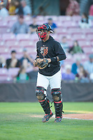 Salem-Keizer Volcanoes catcher Ricardo Genoves (9) during a Northwest League game against the Eugene Emeralds at Volcanoes Stadium on August 31, 2018 in Keizer, Oregon. The Eugene Emeralds defeated the Salem-Keizer Volcanoes by a score of 7-3. (Zachary Lucy/Four Seam Images)