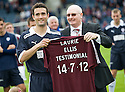 Raith Rovers' Laurie Ellis gets a signed top from former boss John McGlynn to commemorate his testimonial