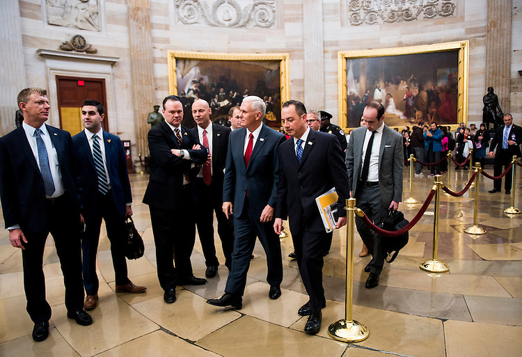UNITED STATES - JANUARY 4: Vice President-elect Mike Pence and Donald Trump's chief of staff Reince Priebus walk through the Capitol Rotunda following a meeting with Senate Minority Leader Chuck Schumer, D-N.Y., on Wednesday, Jan. 4, 2017. (Photo By Bill Clark/CQ Roll Call)