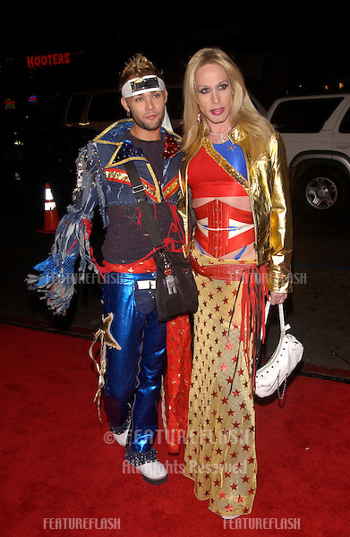 Actor ALEXIS ARQUETTE (right) & REESE (city kid from Amish in the City) at the Los Angeles premiere of Team America: World Police..October 11, 2004