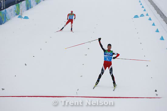Trent Nelson  |  The Salt Lake Tribune.Team 4x5km Nordic Combined on the cross country track at the Whistler Olympic Park, XXI Olympic Winter Games in Whistler, Tuesday, February 23, 2010. austria's Mario Kreiner (front) and USA's bill demong approach the finish line. Austria gold medal, USA silver
