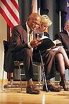 Harry Belafonte and Tina Brown, read notes on stage at the John Jay Justice Award ceremony, April 5 2011.