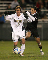 Michael Reyes #9 of Oakland closes in on Alex Yoshinaga #19 of Notre Dame. The University of Notre Dame defeated Oakland University 2-1 in the second round of the NCAA championship at Alumni Field at the University of Notre Dame in South Bend, Indiana on November 28, 2007.