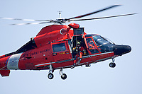 A swimmer prepares to be lowered to the water from a United States Coast Guard HH-65C Dolphin helicopter. The helicopter and crew, based at U.S. Coast Guard Air Station San Francisco, was on a practice mission with the Coast Guard Auxilary to maintain search and rescue proficiency.