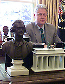 United States President Bill Clinton signs H.R. 4762 to amend the Internal Revenue Code of 1986 to require 527 organizations to disclose their political activities in the Oval Office at the White House in Washington, DC on 1 July, 2000.  Until now, many groups benefiting from the tax-exempt status that section 527 of the Internal Revenue Code confers have evaded federal election laws and masked their funding sources, even while acting directly to influence politics and elections.  The bill signed by President Clinton requires these 527 organizations to disclose their unnamed donors and expenditures.<br /> Credit: Ron Sachs / CNP