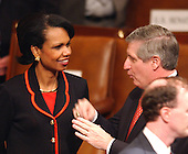 Washington, DC - January 28, 2003 -- National Security Advisor Condoleezza Rice, left, shares some thoughts with White House Chief of Staff Andy Card on the floor of the United States House of Representatives prior to United States President George W. Bush delivering his State of the Union Address to a Joint Session of the United States Congress.<br /> Credit: Ron Sachs / CNP
