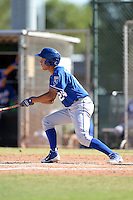 Kansas City Royals shortstop Marten Gasparini (24) at bat during an instructional league game against the Seattle Mariners on October 2, 2013 at Surprise Stadium Training Complex in Surprise, Arizona.  (Mike Janes/Four Seam Images)
