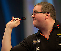 29.12.2014.  London, England.  William Hill World Darts Championship.  Stephen Bunting (27) [ENG] in action during his game with James Wade (6) [ENG]. Bunting won the match 3-1.