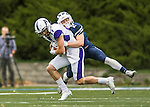 8 October 2016: Amherst College Purple & White Wide Receiver Devin Boehm, a Senior from Wilmette, IL, is tacked by Middlebury College Panther Defensive Back Nate Leedy, a Senior from Naples, FL, at Alumni Stadium in Middlebury, Vermont. The Panthers edged out the Purple & While 27-26. Mandatory Credit: Ed Wolfstein Photo *** RAW (NEF) Image File Available ***