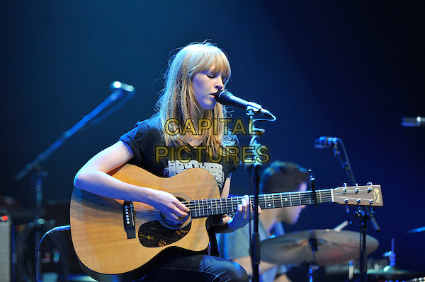 Lucy Rose.performing in concert, Hammersmith Apollo, London, England. .23rd April 2013.on stage live gig performance music half length black t-shirt guitar singing profile.CAP/MAR.© Martin Harris/Capital Pictures.