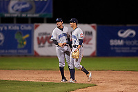 Lake County Captains Tyler Freeman (7) and Daniel Schneemann (15) celebrate a victory after a Midwest League game against the Beloit Snappers at Pohlman Field on May 6, 2019 in Beloit, Wisconsin. Lake County defeated Beloit 9-1. (Zachary Lucy/Four Seam Images)