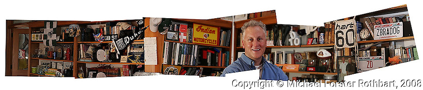 "Mark Schmitz, the founder and creative director of Zebra Dog Studios, stands in his office in downtown Madison, which is filled with the graphic design materials he's collected over the decades. Zebra Dog creates ""miniature museums"" and other three-dimensional exhibits that blend branding, marketing and history.<br /> <br /> Client: Wisconsin State Journal<br /> © Michael Forster Rothbart<br /> www.mfrphoto.com <br /> 607-267-4893 o 607-432-5984<br /> 5 Draper St, Oneonta, NY 13820<br /> 86 Three Mile Pond Rd, Vassalboro, ME 04989<br /> info@mfrphoto.com<br /> Photo by: Michael Forster Rothbart<br /> Date: 4/2008    File#:  Canon 20D digital camera frames/digital collage"