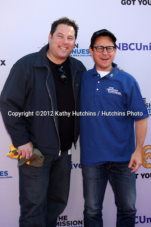 """LOS ANGELES - NOV 9:  Greg Grunberg, JJ Abrams at the Veterans Day Service Event to feed LA Children sponsored by """"The Mission Continues"""" and """"Got Your 6"""" organizations. at Globe Theater at Universal Studios on November 9, 2012 in Los Angeles, CA"""