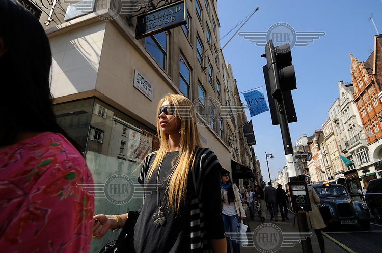 Young woman on Bond Street, London.